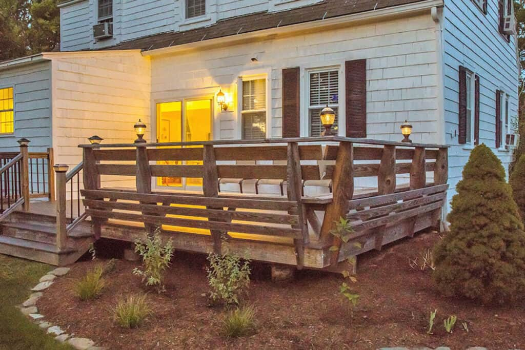 Wooden deck off of the back of the cottage.
